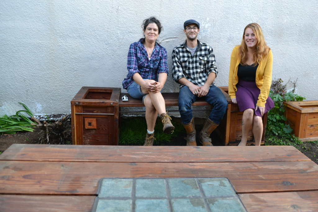 Artisan Katherine Gulley of Raised Bedlam Woodworks (left), Green Educator Ezra Ranz (center), JCC East Bay Berkeley After School Director Cassie Brown (right) enjoy the new beautiful redwood garden furniture that arrived in November.